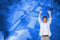 Cheering male with arms up. Composite image of cheering male with arms up Royalty Free Stock Image