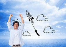 Cheering male with arms up Royalty Free Stock Photo