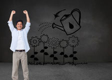 Cheering male with arms up Stock Photos