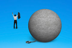 Cheering man free from concrete ball shackle Royalty Free Stock Photo