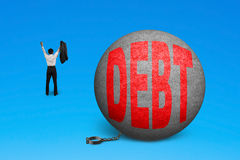 Cheering man free from debt ball shackle Stock Photo