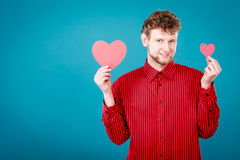 Cheering man holding hearts. Royalty Free Stock Photos