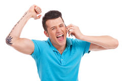Cheering man on the phone Royalty Free Stock Image