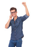 Cheering man on the phone Stock Photos