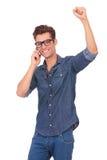 Cheering man on the phone Stock Photos