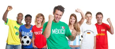 Cheering mexican soccer supporter with fans from other countries royalty free stock photography