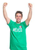 Cheering mexican sports fan. Cheering football fan from Mexico in a green jersey laughing at camera on a isolated white background Stock Photography