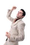 Cheering novo bem sucedido do homem de negócios Fotografia de Stock