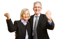 Cheering old senior couple clenching fists Royalty Free Stock Photos