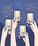 Cheering people and fireworks. Hands holding smartphones with fireworks on the background Stock Photo