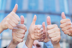 Cheering people holding thumbs up Royalty Free Stock Photography