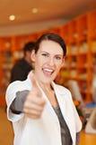 Cheering pharmacist in drugstore Stock Photo