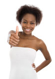 Cheering pretty colored afro american girl with thumb up. Stock Photo