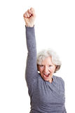 Cheering senior woman clenching her Royalty Free Stock Images