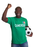 Cheering Soccer fan from Cameroon with ball. On an isolated white background for cutout royalty free stock photography