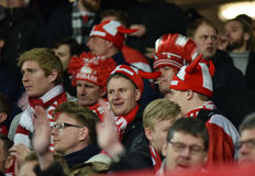 Cheering soccer fans of Denmark celebrating in tribune during a Stock Photo
