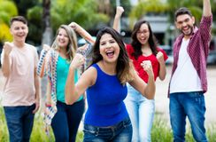Cheering spanish girl with happy group of friends royalty free stock photo