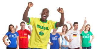 Cheering sports fan from Brazil with fans from other countries. Cheering soccer fan from Brazil with fans from Italy, Spain, USA, Argentina, Germany and Mexico Royalty Free Stock Photos