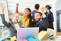 Cheering start-up team celebrating. Their success with enthusiasm Stock Photo
