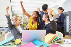 Cheering start-up team at work. Cheering start-up team celebrate success at work Royalty Free Stock Photo