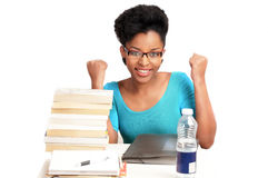 Cheering student. Pretty student sitting at desk cheering her success Stock Image