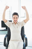 Cheering stylish brunette businesswoman raising her arms Royalty Free Stock Photos