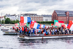 Cheering supporters on canal boats in Copenhagen. Royalty Free Stock Photos