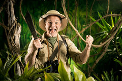 Cheering survival explorer in the jungle Stock Photography