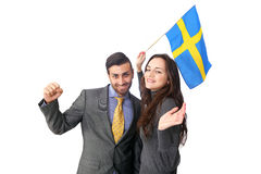 Cheering Sweden couple. Couple cheering Sweden waving flag with happy expression Stock Photography