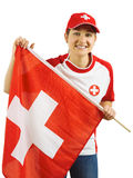 Cheering for Swiss sports team. Photo of a beautiful sports fan from Switzerland holding a Swiss flag Royalty Free Stock Images