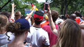 Cheering Team USA. Video of people at dupont circle in washington dc watching the world cup soccer game between germany and the united states on 6/26/14. The stock video footage