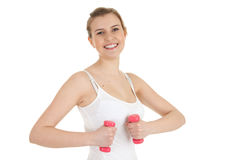 Cheering teenage girl with small dumbbells Royalty Free Stock Photography