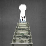 Cheering on top of money stairs with key hole Stock Image