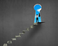 Cheering on top of money stairs with key hole Royalty Free Stock Image