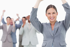 Cheering tradeswoman with team behind her Royalty Free Stock Photo