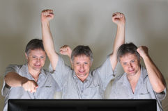 Cheering triplets Stock Photography