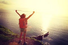 Cheering woman backpacker enjoying the view Stock Photos