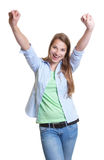 Cheering woman with blond hair in casual clothes Royalty Free Stock Photo