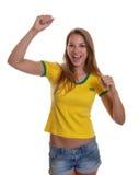 Cheering woman in a brazilian shirt Stock Photo