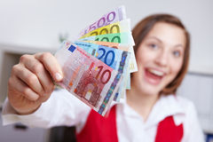 Cheering woman with Euro money Royalty Free Stock Photos