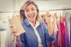 Cheering woman going shopping and showing wallet Royalty Free Stock Photography