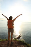 Cheering woman hiker open arms Royalty Free Stock Photos