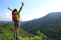 Cheering woman hiker open arms Royalty Free Stock Image