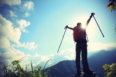 Cheering woman hiker open arms Stock Images