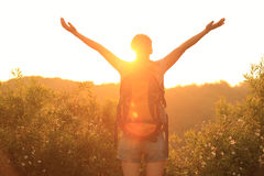 Cheering woman hiker raised arms mountain top Royalty Free Stock Images