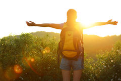 Cheering woman hiker raised arms mountain top Royalty Free Stock Photography