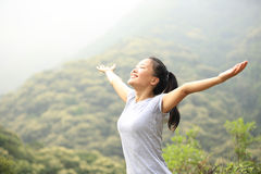 Cheering woman hiker Stock Photo