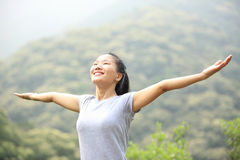 Cheering woman hiker Royalty Free Stock Images