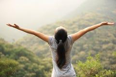 Cheering woman hiker Stock Image
