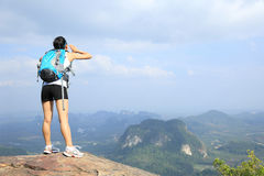 Cheering woman hiker yell at mountain peak Royalty Free Stock Image